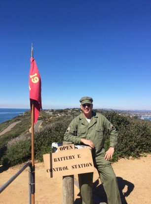 Author/historian Kenneth Glaze enjoys a beautiful sky over Cabrillo National Monument at the entrance of the restored base end station of San Diego's largest gun. (Photo courtesy Karen Scanlon.)