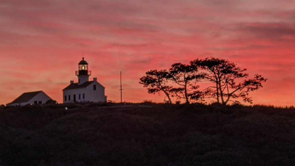 Lighthouse with orange sky at sunset