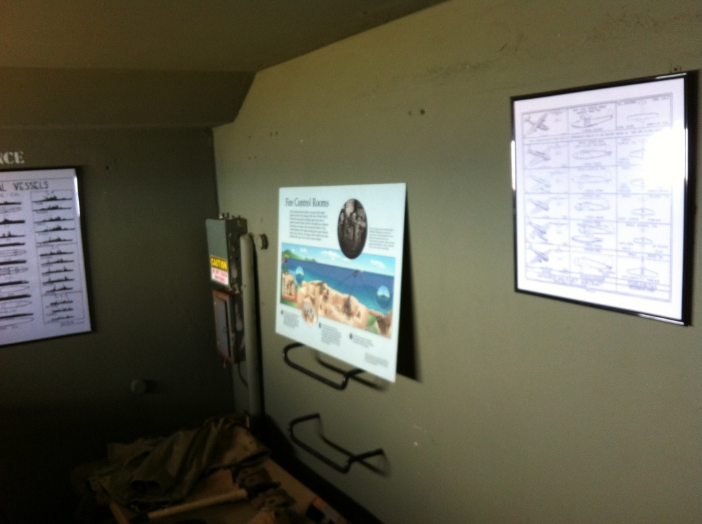 The inside of a room in the bunker. Various displays are seen on the walls.